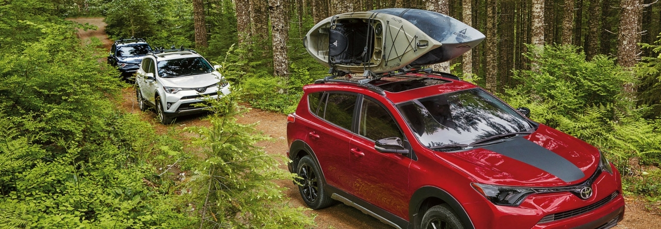 The 2018 RAV4 hauling kayaks in the woods in a blog post about Toyota cars in Raleigh, NC.
