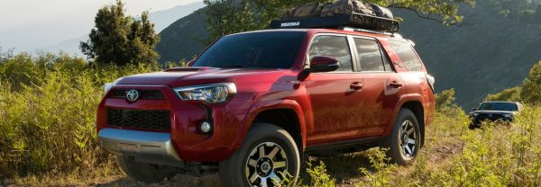 The 2018 Toyota 4Runner driving through a field.
