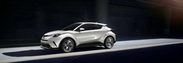 2019 Toyota C-HR driving down the street