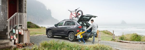 Car owner loading up 2019 Toyota RAV4 next to a lake