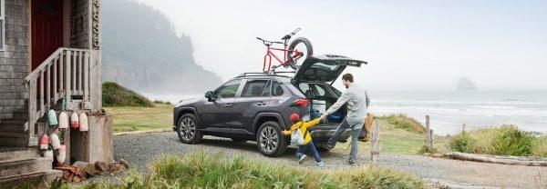 Car owner loading up 2019 Toyota RAV4 next to a lake